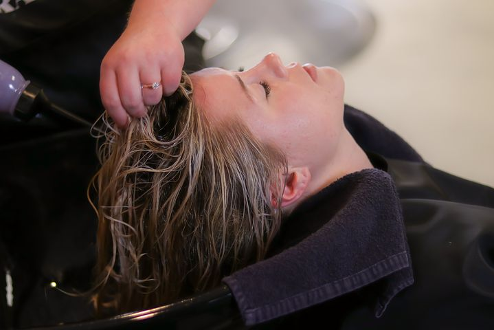 woman having her her treated in a salon